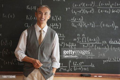 Portrait of teacher with in front of blackboard