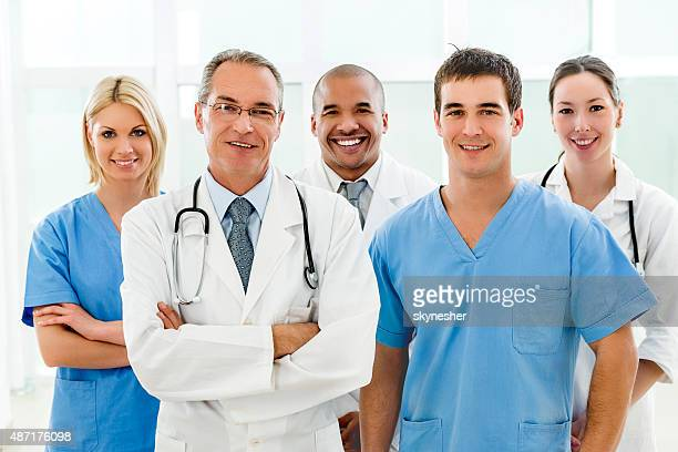 Portrait of team of doctors looking at camera.