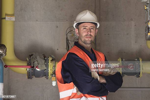 Portrait of technician with arms folded in power station