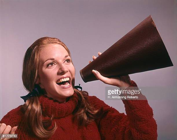 Portrait Of Teen Cheerleader Shouting Into Megaphone Happy Team Spirit Woman Outdoor.
