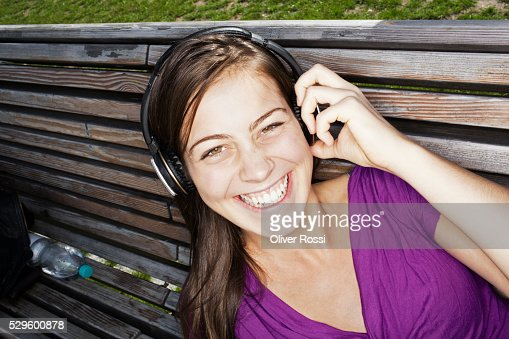 Portrait of teen (16-17) girl listening to music : Stock Photo