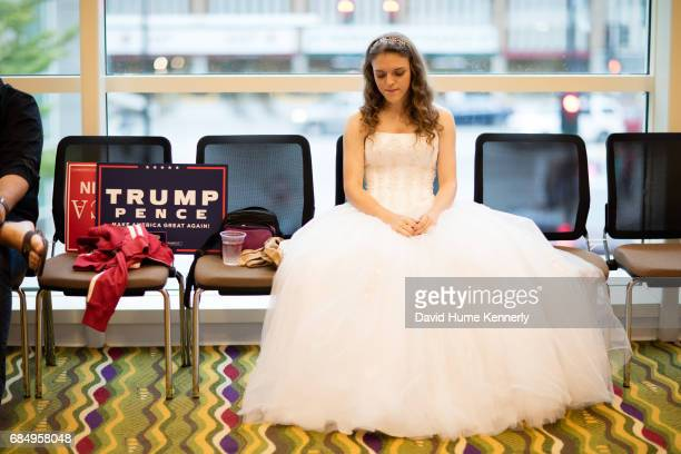 Portrait of teen singer Anastasia Lee dressed in a white tulle dress as she sits on a chair in the KI Convention Center before one of Donald Trump's...