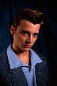 Portrait of teenage boy with pompadour
