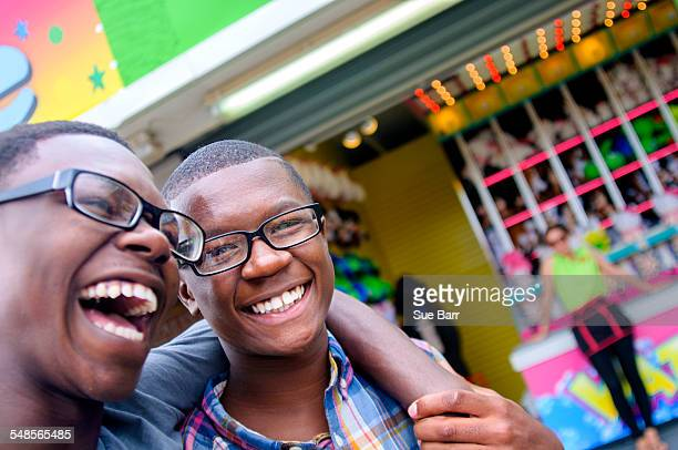 Portrait of teenage boys laughing at amusement park