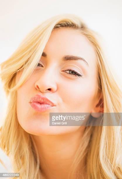 Portrait of teenage girl (16-17) blowing kiss
