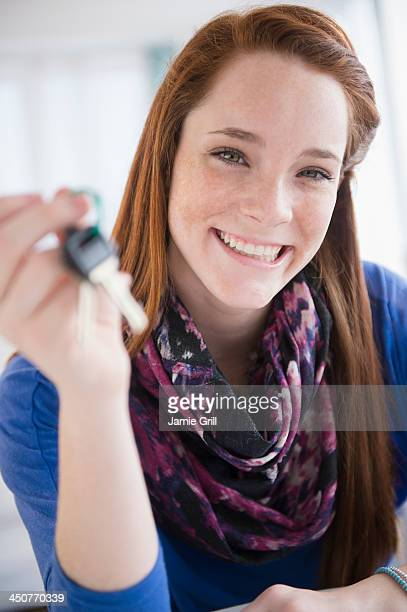 Portrait of teenage girl (14-15) holding car key