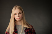 Portrait of teenage girl in studio on black background