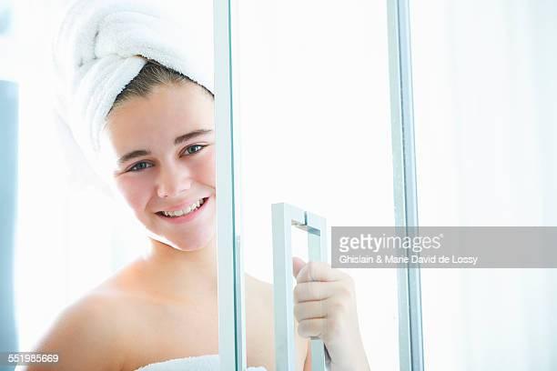 Portrait of teenage girl leaving shower