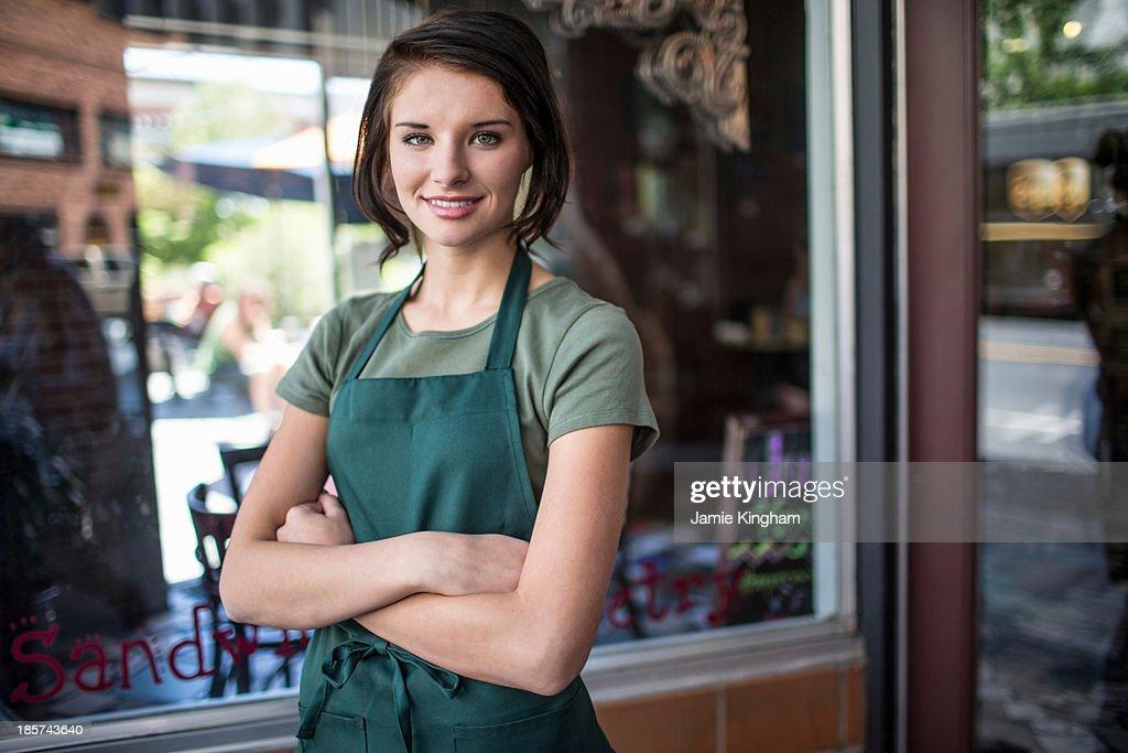 Portrait of teenage girl outside cafe