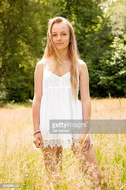 Portrait of teenage girl standing in field