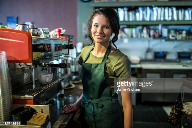 Portrait of teenage waitress in coffee house
