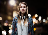 portrait of teenager in city at night.