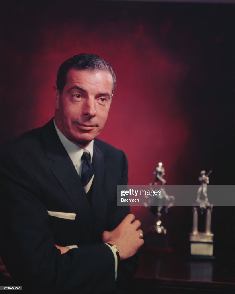 A portrait of the American baseball player <a gi-track='captionPersonalityLinkClicked' href=/galleries/search?phrase=Joe+DiMaggio&family=editorial&specificpeople=93596 ng-click='$event.stopPropagation()'>Joe DiMaggio</a> (1914 - 1999) with two of his trophies, New York, 1954. During his career with the New York Yankees from 1936 to 1951, he established the consecutive hitting streak record of 56 games in major league baseball.