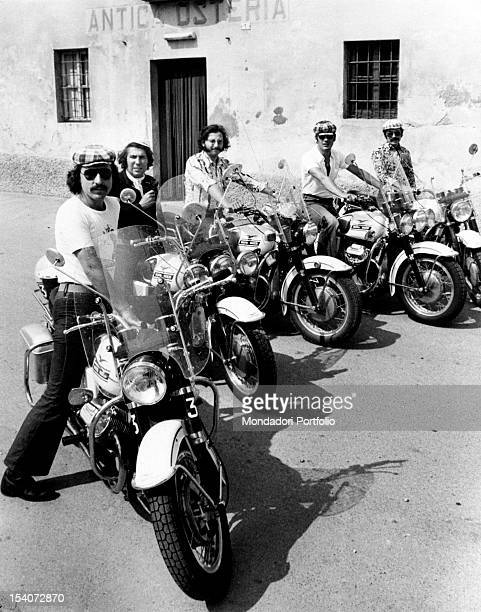Portrait of the band Dik Dik on motorcycles in front of Antica Osteria The Italian band is composed by the drummer Sergio Panno the guitarist Pepe...