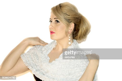 portrait of the beautiful blonde in a white knitted scarf : Stock Photo