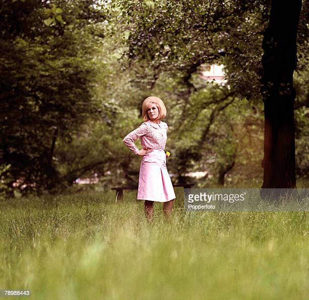 1965 A portrait of the British singer Dusty Springfield standing in a woodland park looking towards the camera