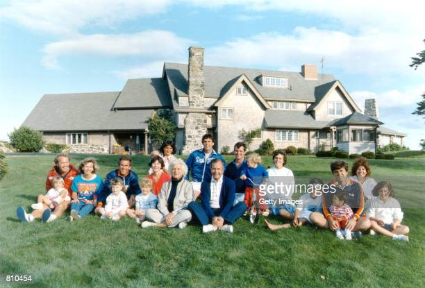 Portrait of the Bush family in front of their Kennebunkport Maine August 24 1986 BACK ROW Margaret holding daughter Marshall Marvin Bush Bill LeBlond...