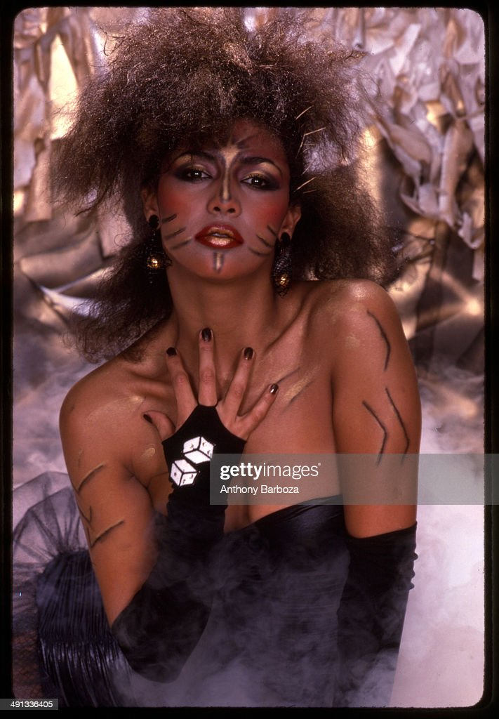 Portrait of the Canadian singer, actress, and model Vanity (born Denise Matthews), as she poses in costume during a cover shoot for funk group Cameo's 'She's Strange' album, 1984. Vanity did not perform on the record.