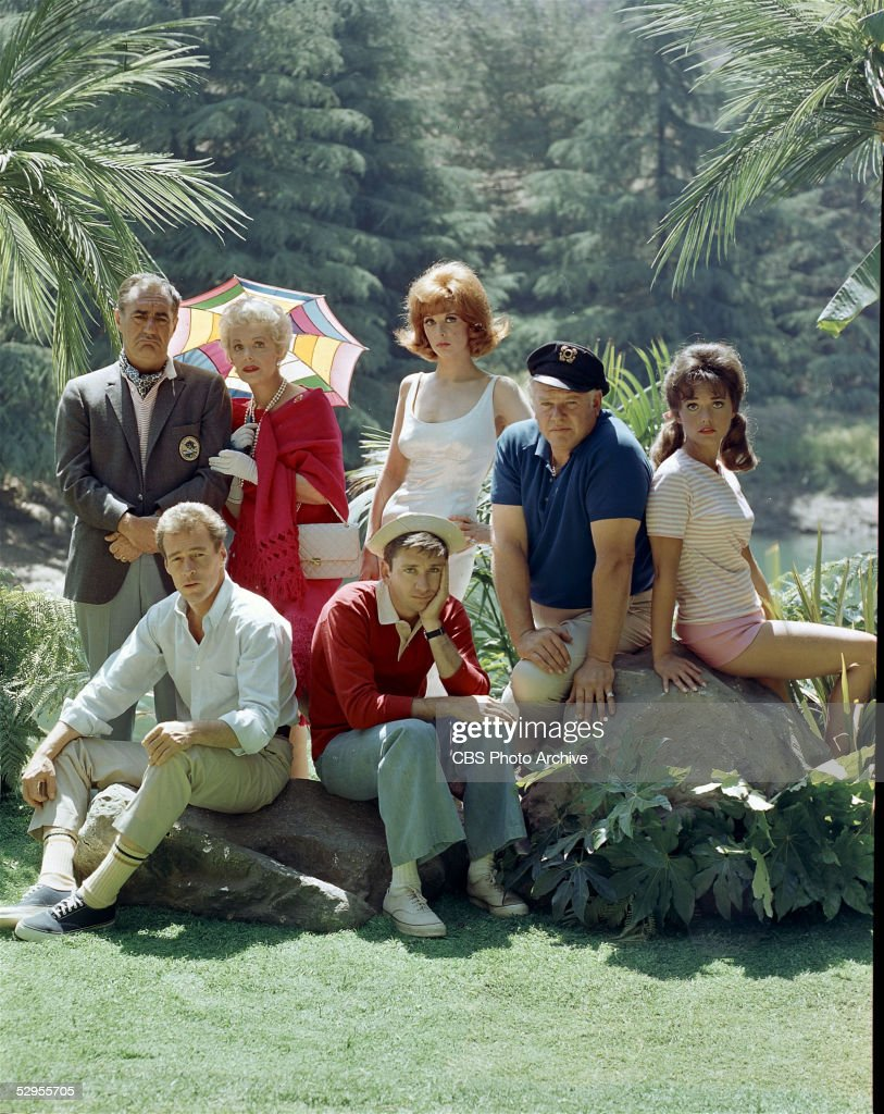 Portrait of the cast of 'Gilligan's Island,' 1964. Back row, from left, American actors Jim Backus (1913 - 1989) as Thurston Howell III, Natalie Schafer (1900 - 1991) as Mrs. Howell, Tina Louise as Ginger Grant, Alan Hale Jr. (1918 - 1990) as the Skipper, and Dawn Wells as Mary Ann Summers; front row, from left, Russell Johnson as the Professor and Bob Denver as Gilligan.