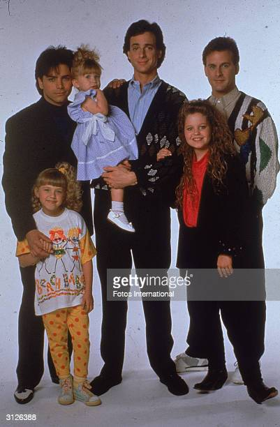 Portrait of the cast of the television program 'Full House' John Stamos Jodie Sweetin Ashley or MaryKate Olsen Bob Saget Candace Cameron and David...