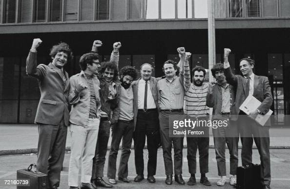 Portrait of the Chicago Seven and their lawyers as they raise they're fists in unison outside the courthouse where they were on trial for conspiracy...