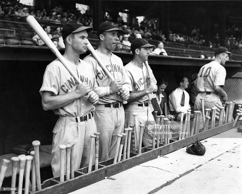 Portrait of the Cincinnati Reds outfield standing in the dugout from left centerfielder Harry Craft left fielder Wally Berger and right fielder Ival...