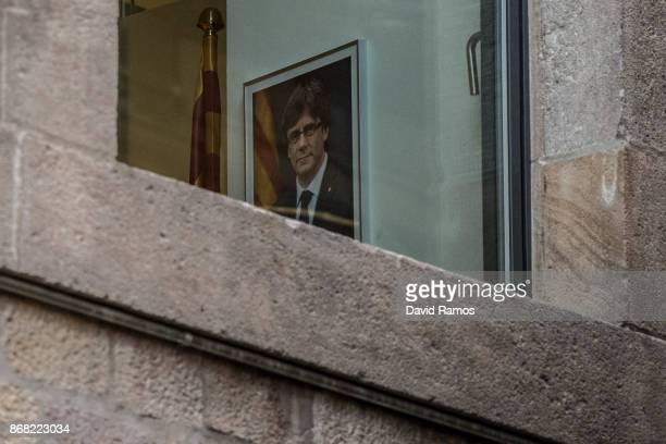 A portrait of the deposed President of Catalonia Carles Puigdemont hangs on a wall inside the Catalan Government building Palau de la Generalitat on...