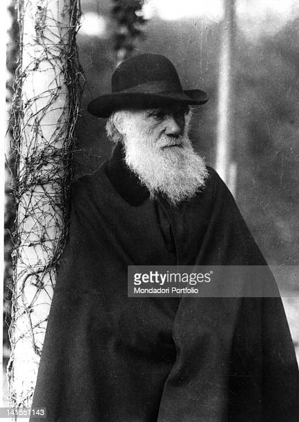 Portrait of the English naturalist Charles Darwin with cloak and hat 1880s