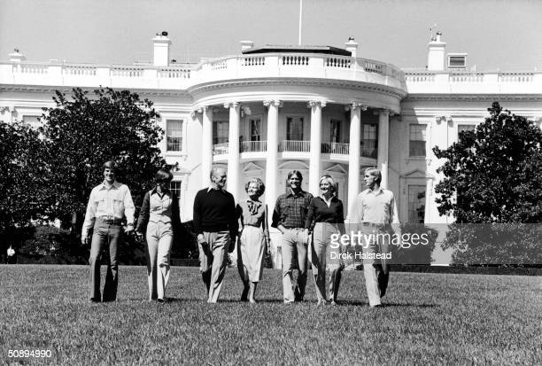 Portrait of the Ford family as they walk across the White House lawn Washington DC September 6 1976 Left to right son Michael and his wife Gayle Ann...