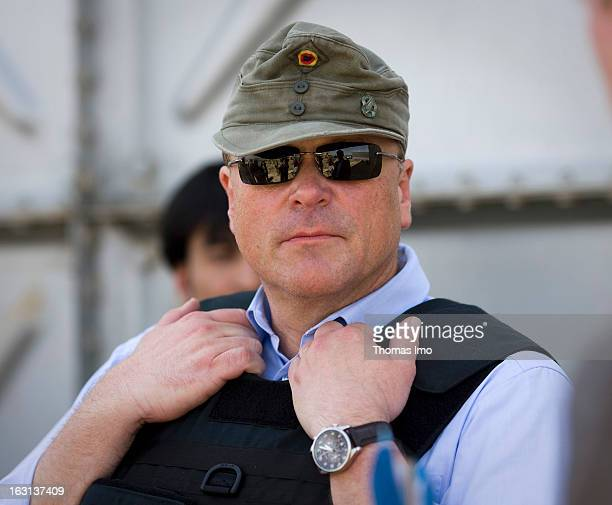 Portrait of the German Federal Minister for Economic Cooperation and Development Dirk Niebel wearing sunglasses and a hat
