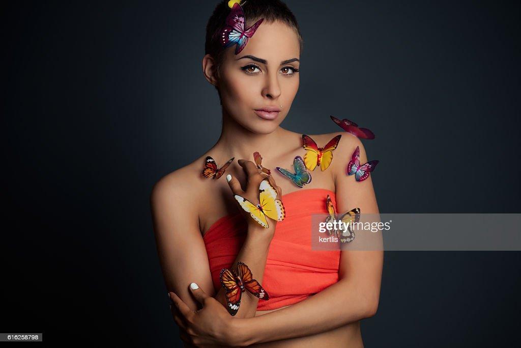 Portrait of the girl and butterflies : Foto de stock