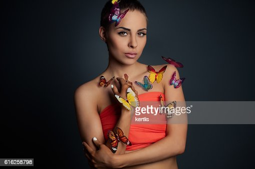Portrait of the girl and butterflies : Stock Photo