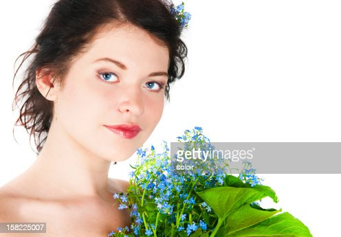 Portrait of the girl with forget-me-nots : Stock Photo
