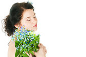 Portrait of the girl with forget-me-nots on a white background