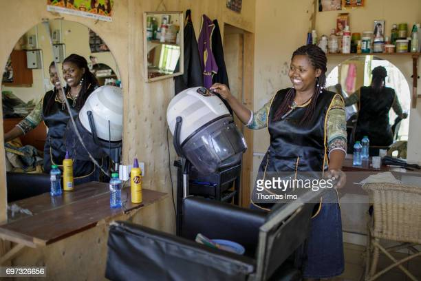 Portrait of the hairdresser Emma Kinyanjui operator of a barber and cosmetic salon at work on May 17 2017 in Talek Kenya