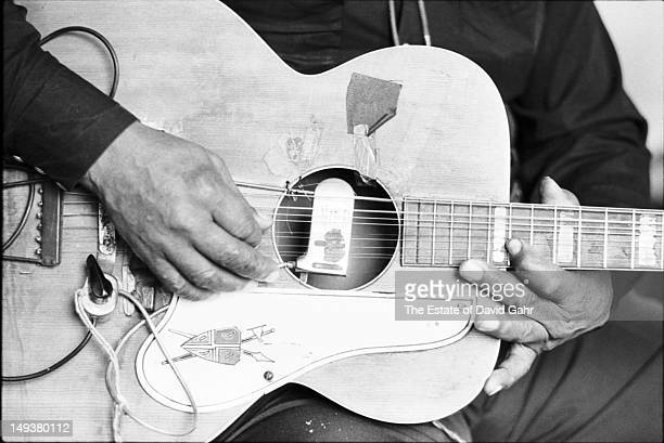Portrait of the hands and guitar of blues guitarist and singer Big Joe Williams in the recording studios of Folkways Records in February 1966 in New...