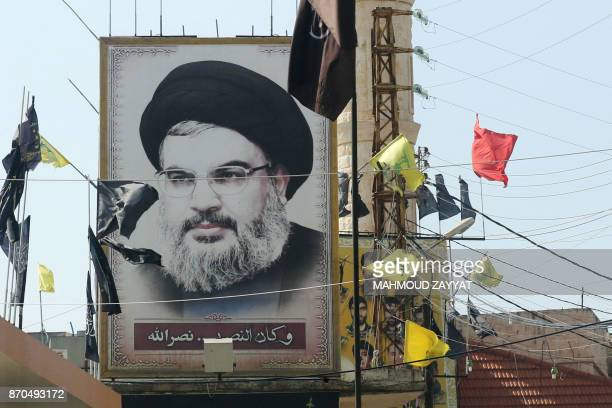 A portrait of the head of the Lebanese Shiite movement Hezbollah Hasan Nasrallah is seen on November 5 in the southern Lebanese village of Adshit...
