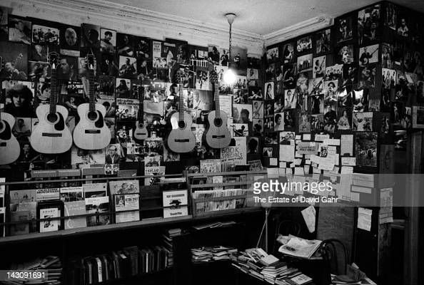 A portrait of the interior of folk music impresario and proprietor Izzy Young's legendary folk music and book shop The Folklore Center on Sixth...