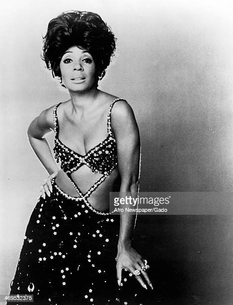 Portrait of the internationally renowned Welsh black singer Shirley Bassey wearing a glamorous sequinned evening gown 1970