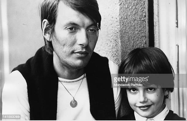Portrait of the Italian singersongwriter Fabrizio De Andre with son Cristiano 1970s