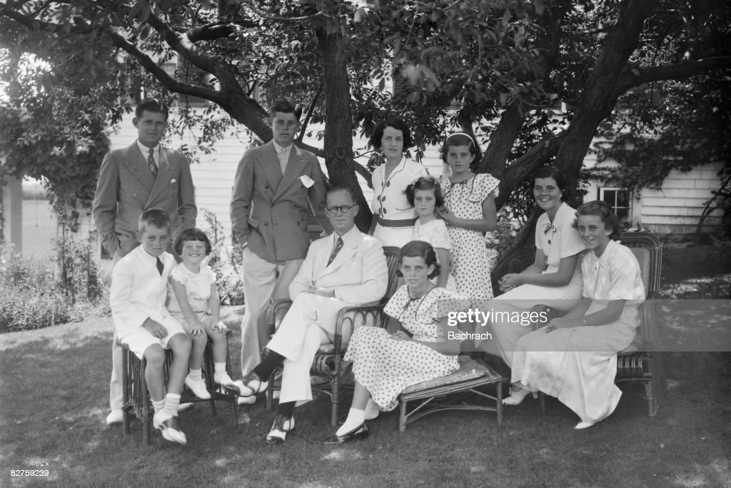 A portrait of the Kennedy family as they sit in the shade of some trees, Hyannis, Massachussetts, 1930s. Seated from left, <a gi-track='captionPersonalityLinkClicked' href=/galleries/search?phrase=Robert+Kennedy+-+Attorney+General&family=editorial&specificpeople=94001 ng-click='$event.stopPropagation()'>Robert Kennedy</a> (1925 - 1968), Edward Kennedy, Joseph P Kennedy Sr (1888 - 1969), Eunice Kennedy, <a gi-track='captionPersonalityLinkClicked' href=/galleries/search?phrase=Rosemary+Kennedy&family=editorial&specificpeople=224828 ng-click='$event.stopPropagation()'>Rosemary Kennedy</a> (1918 - 2005), and Kathleen Kennedy (1920 - 1948); standing from left, Joseph P Kennedy Jr (1915 - 1944), John F Kennedy (1917 - 1963), <a gi-track='captionPersonalityLinkClicked' href=/galleries/search?phrase=Rose+Kennedy&family=editorial&specificpeople=92491 ng-click='$event.stopPropagation()'>Rose Kennedy</a> (1890 - 1995), Jean Kennedy, and Patricia Kennedy (1926 - 2006).