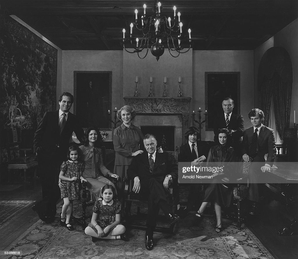 Portrait of the Lauder family taken at home of Joseph (1902 - 1982) and Estee Lauder (1906 - 2004), New York, New York, 1979. Pictured are: Joseph and Estee's son Ronald (left), his daughter Aerin and Jane (seated on floor), and his wife Jo Carole; in the middle are Estee and Joseph (seated); 2nd from right: Estee and Joseph's other son Leonard, his sons Gary and William (right) and his wife Evelyn.