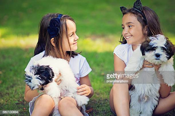 Portrait of the little girls with their dogs