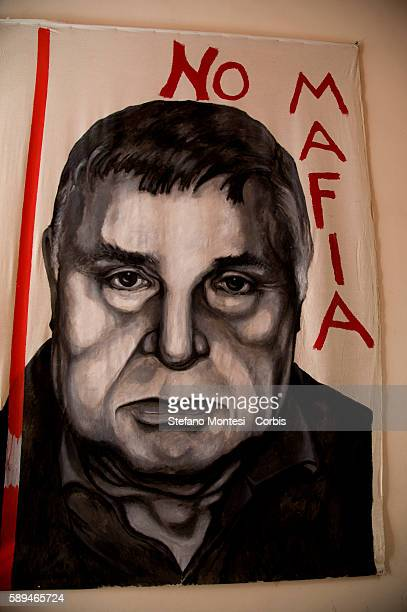 A portrait of the Mafia boss Salvatore Riina is displayed at the entrance of the International Centre for Documentation on the Mafia and the...