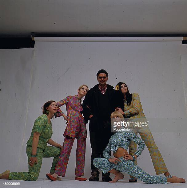 1967 Portrait of the models Twiggy Joanna Lumley Joy Rance and Vicky Hodge in a studio modeling multicoloured two piece trouser suits surrounding a...
