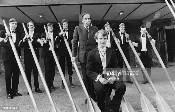 Portrait of the Oxford University rowing eights team wearing evening dress prior to their battle with the Cambridge team with former Liberal Party...