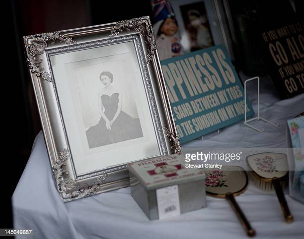 A portrait of the Queen on sale on a stall at the Ightham medieval Coxcombe Fair to celebrate Queen Elizabeth II's Diamond Jubilee on June 03 2012 in...