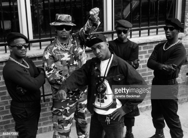Portrait of the rap hiphop group Public Enemy Chuck D leader of the group stands in the center of the band 1987 New York