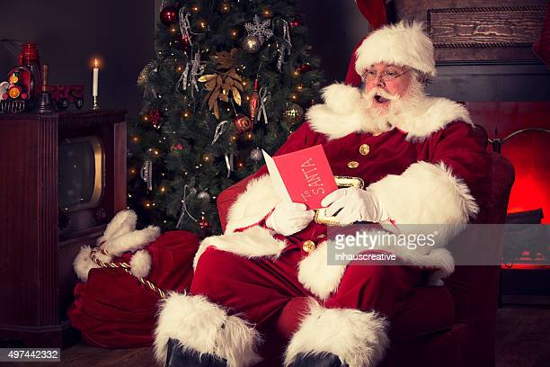 Portrait of the Real Santa Claus reading Christmas Card