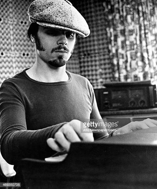 Portrait of the songwriter and musician Peter Brown seated at a piano or mixing desk in a recording studio January 13 1979